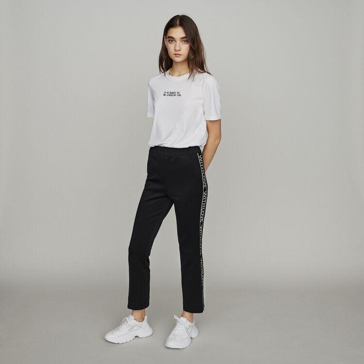 Pantaloni elasticizzati con bande : Pantaloni colore Nero
