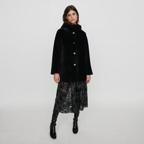 Montone reversibile con cappuccio : Cappotti e Giubbotti colore Nero