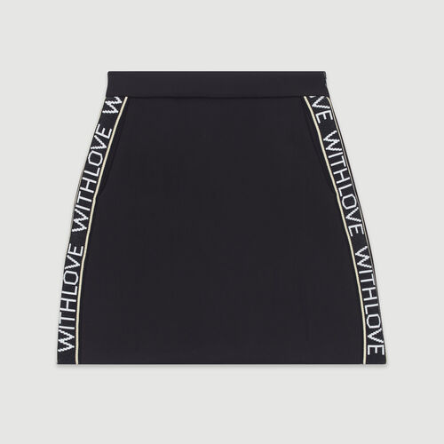 Gonna corta con bande con messaggio : Gonne e shorts colore Nero