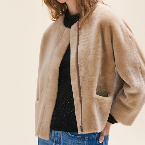 Giubbotto reversibile in shearling : Black friday colore Beige