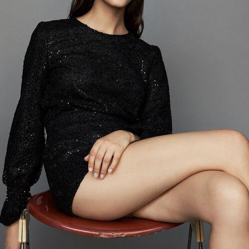 Tuta pantalone corta in pizzo : Gonne e shorts colore Nero