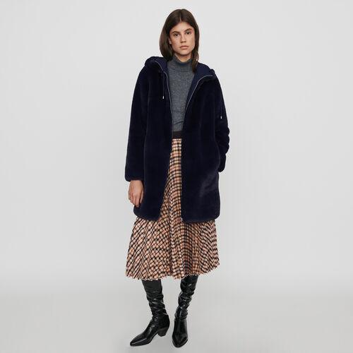 Giubbotto in eco-pelliccia con cappuccio : Cappotti e Giubbotti colore Blu