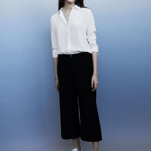 Pantaloni tailleur larghi : Pantaloni colore Nero