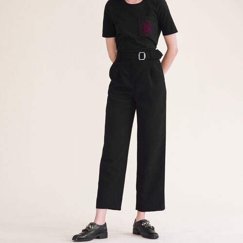 Pantaloni larghi con cintura : Pantaloni colore Nero